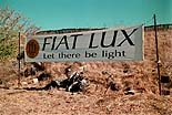Photo of Fiat Lux/Let there be light banner at main gate to campus